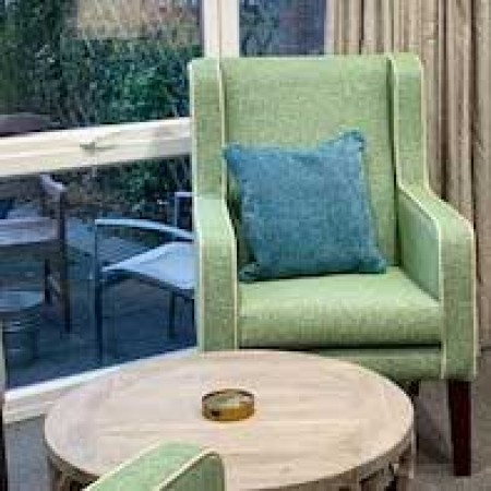 Arran High Back Generous Contract chair for in care home setting in green fabric with piping