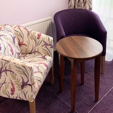 Classic Stratford tub chair for hotels, sports and social clubs, care homes and nursing homes in SMD ILIV Susanna fabric - here in lounge setting